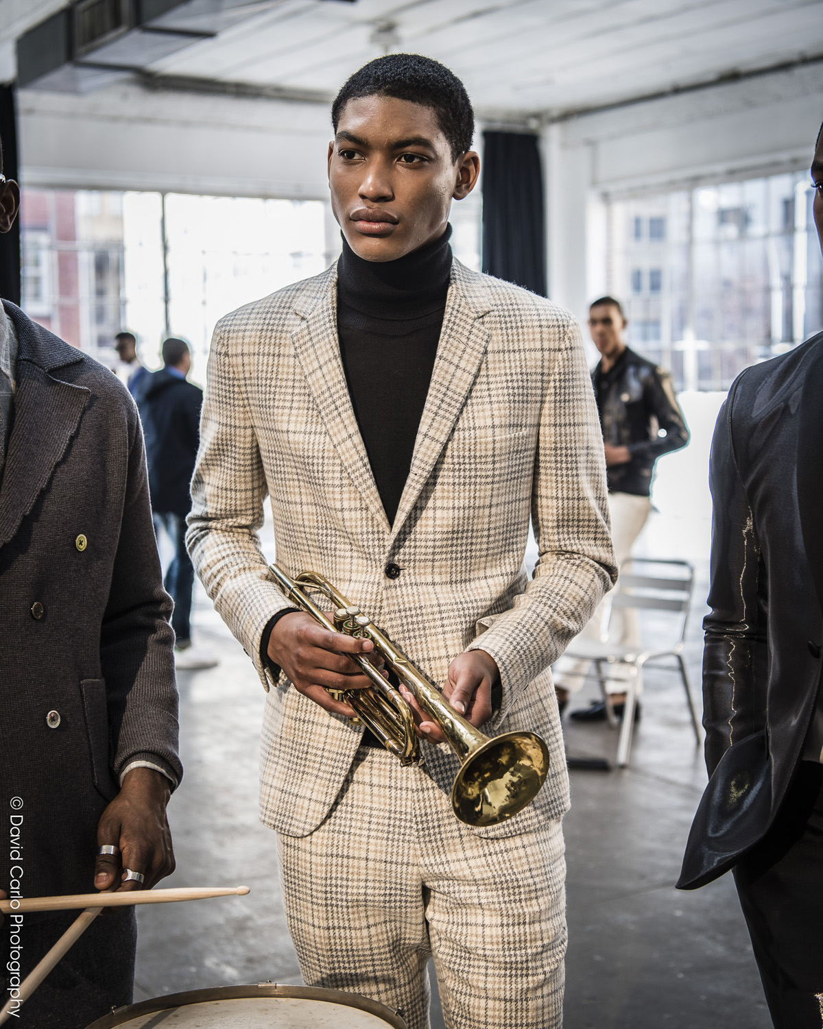 Lets trumpet in praise of this houndstooth plaid wool suit.
